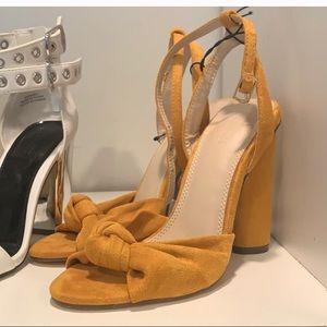 Yellow bow heels